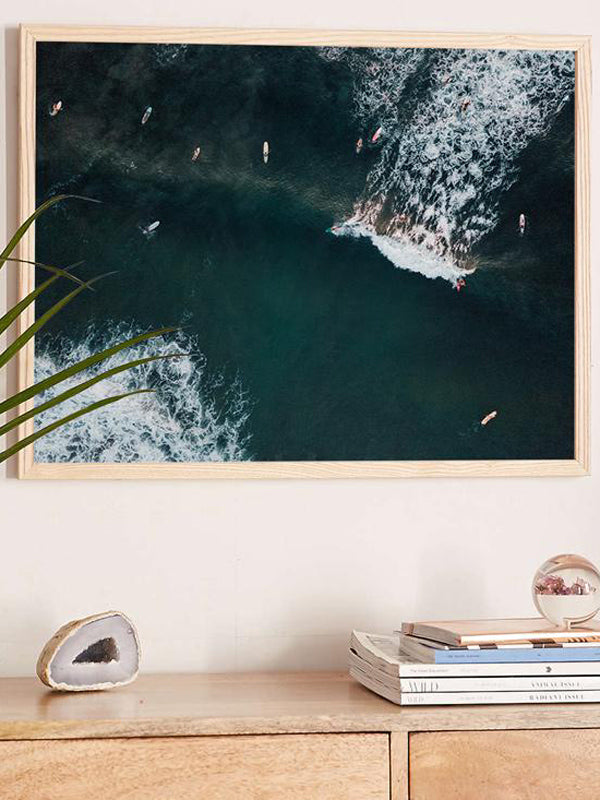 You Go Left and I'll Go Right aerial surfer print by Samba to the Sea at The Sunset Shop. Image is an aerial photo of surfer's splitting the peak in Tamarindo, Costa Rica.