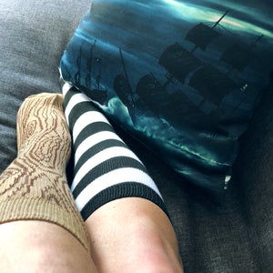 Peg leg socks with pirate ship throw pillow
