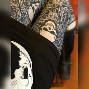 Skull print leggings close up with skull moon dress and boots