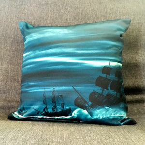 Blue, white, and black pirate ships on a square throw pillow