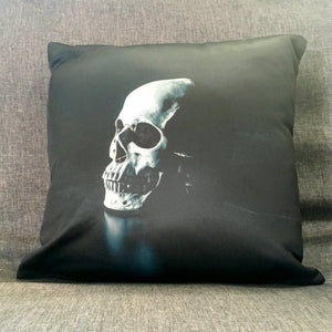 Throw pillow with single skull facing at an angle