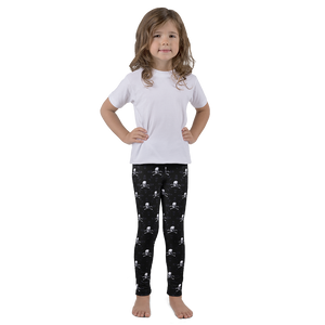 Front view of a young girl wearing skull and crossbones leggings
