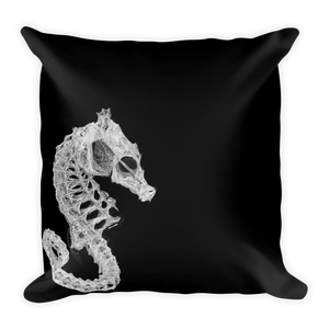 Square black throw pillow with seahorse skeleton print
