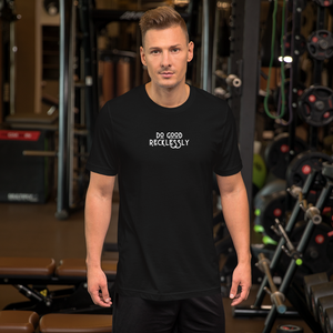 "Man in shirt that reads ""do good recklessly"" at the gym"