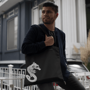 Man carrying reusable cloth tote with seahorse skeleton