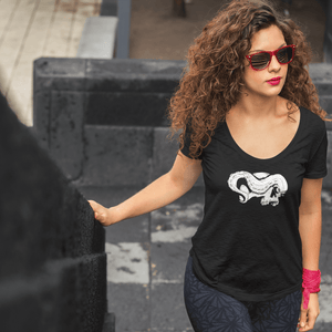 Woman with long hair wearing a black scoop neck shirt with skull and tentacle print