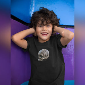 Young boy at play wearing short sleeve kid's spiral skull print t-shirt