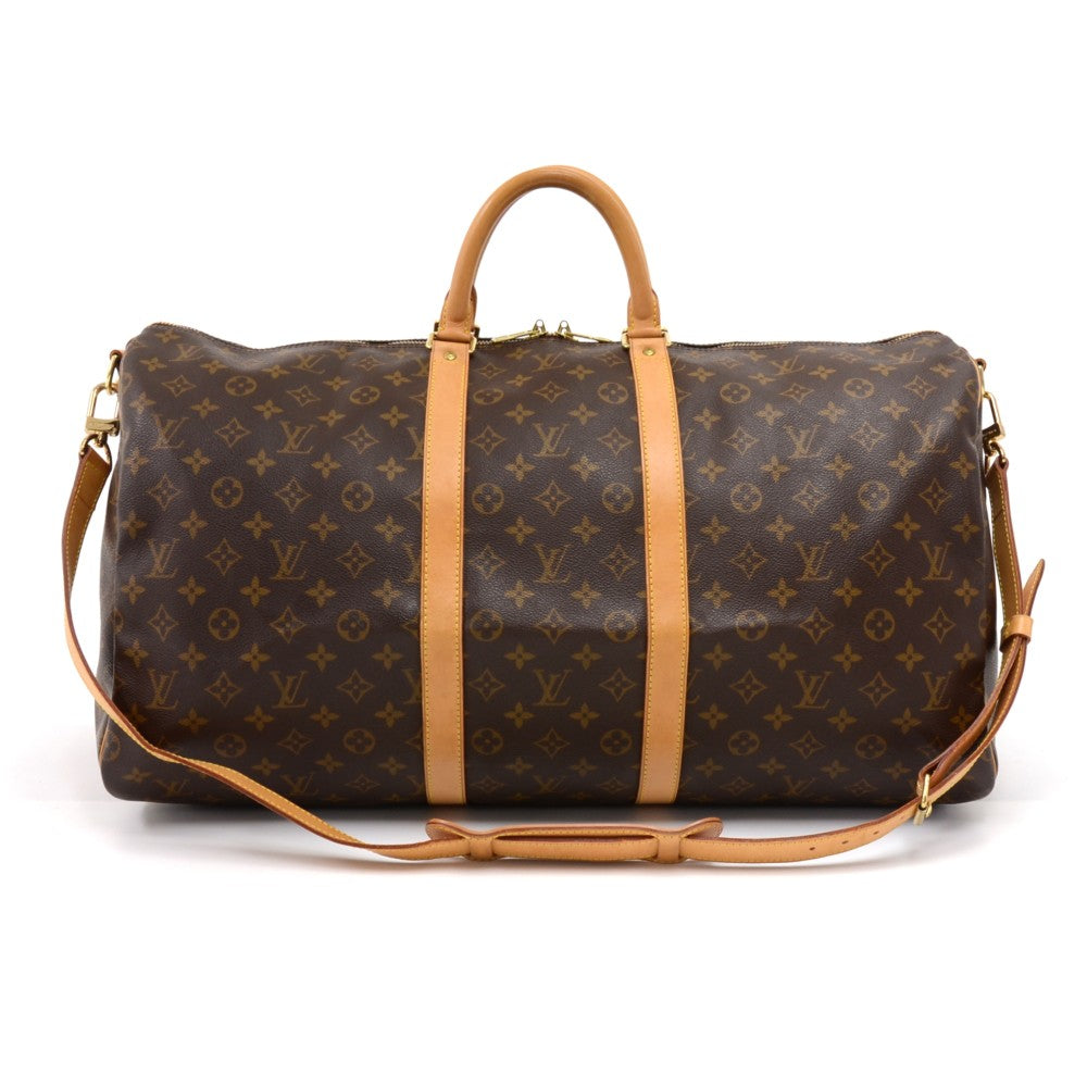 a04f9473031f Keepall 55 Bandouliere Monogram Canvas Travel Bag with Strap. Next. Louis  Vuitton