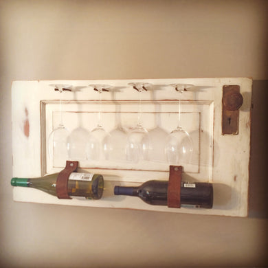 Bottle and Glass holder on an antique door
