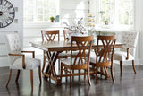 Heyerly dining suite shown with Alana arm chairs and Oletta side chairs