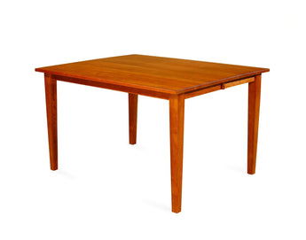 Gathering Leg table shown in Cherry/Malaguania