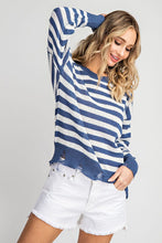 Blue striped sweater with distressed detail