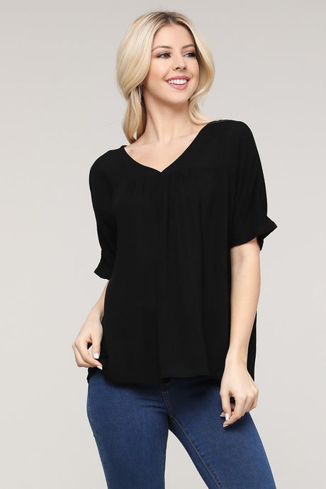 Black v-neck short sleeve top with shirring