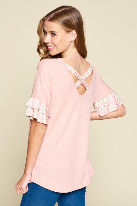 Top with leopard ruffle sleeves and cross back