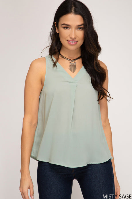 Sleeveless top with front pleat