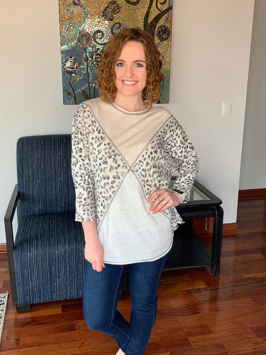 Ivory/leopard diamond pattern top