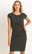 Black dress with white polka dots