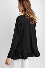 Long sleeve top with ruffle hem