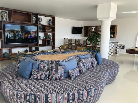 flat screen TV and lounge area at Mar del Cabo