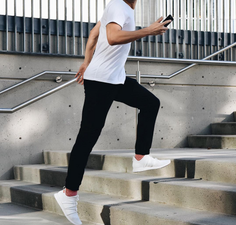 Basic white t-shirt with black jeans and white Rbutus athleisure shoes from SKYE Footwear