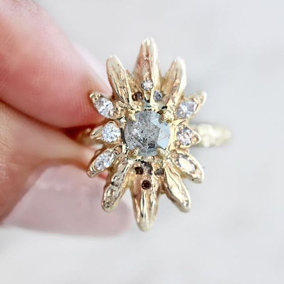 gold starburst ring with diamonds