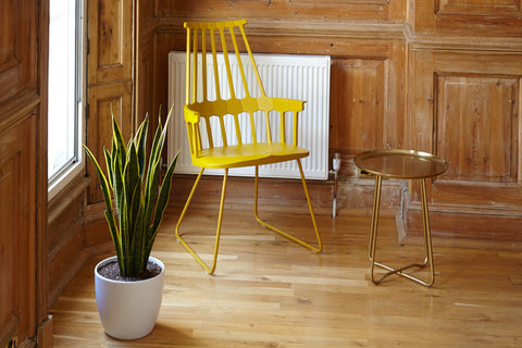 Yellow chair and gold side table