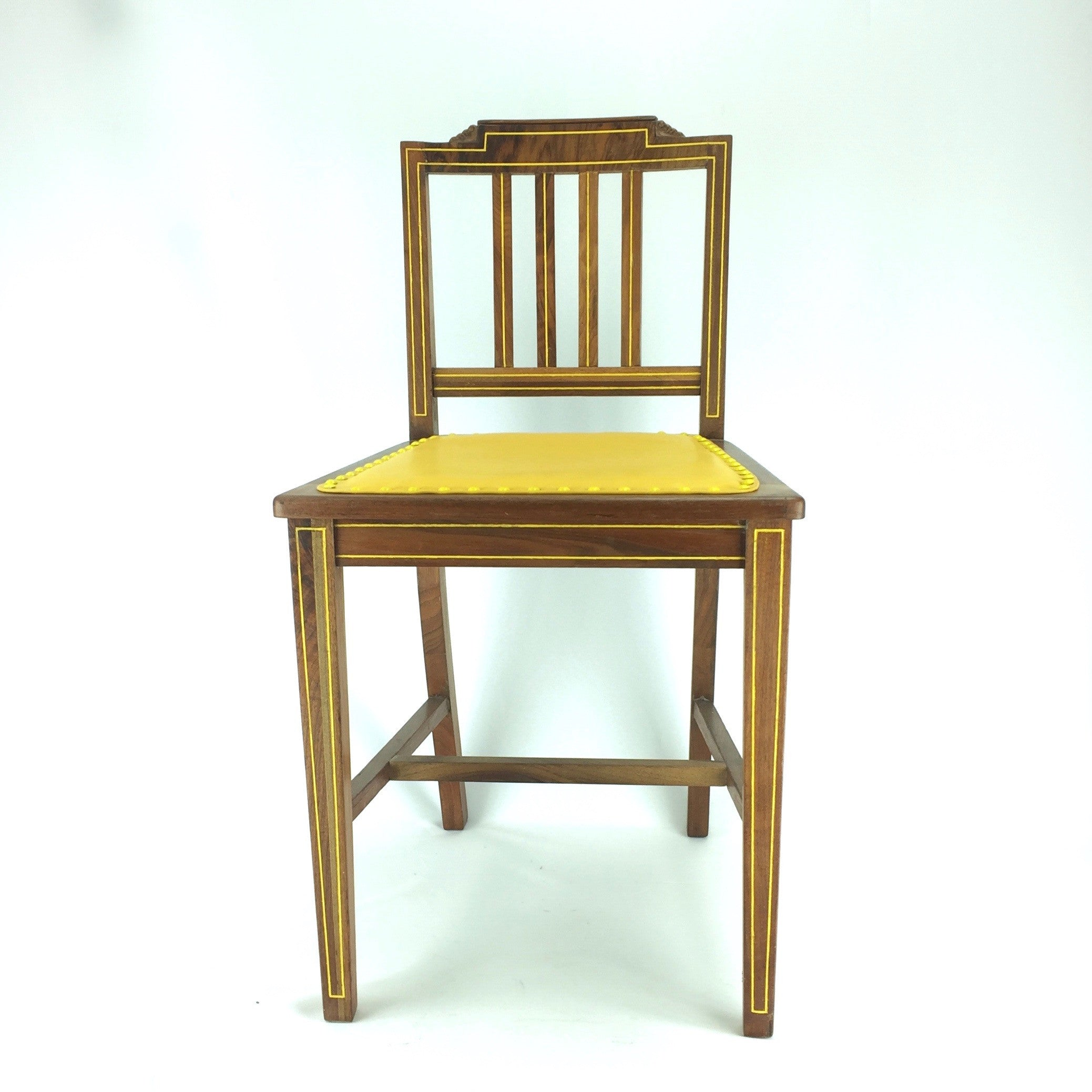 wooden chair with yellow leather