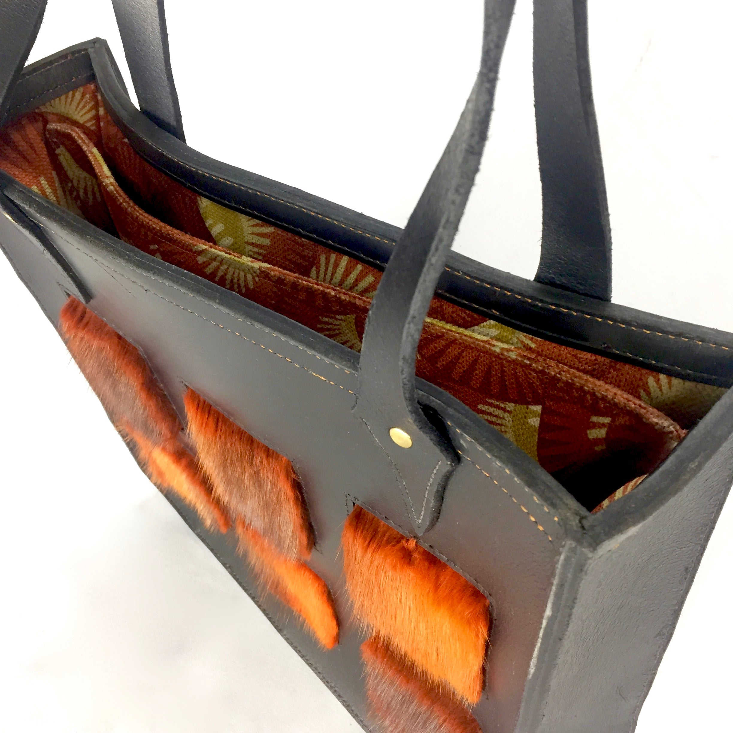 leather and fur black and orange purse