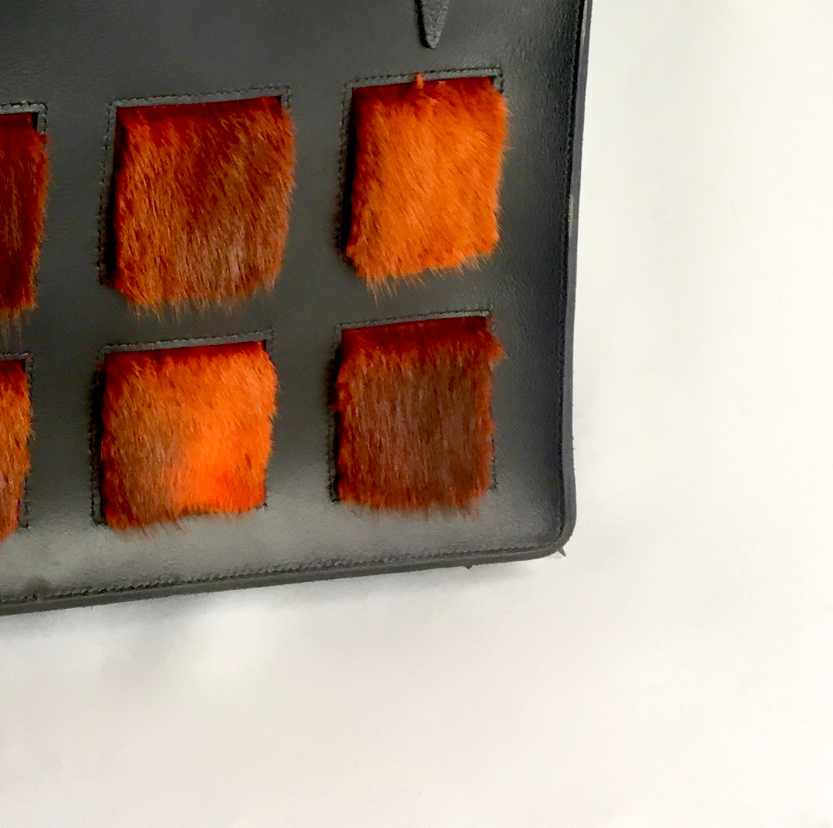 orange muskrat fur black leather purse