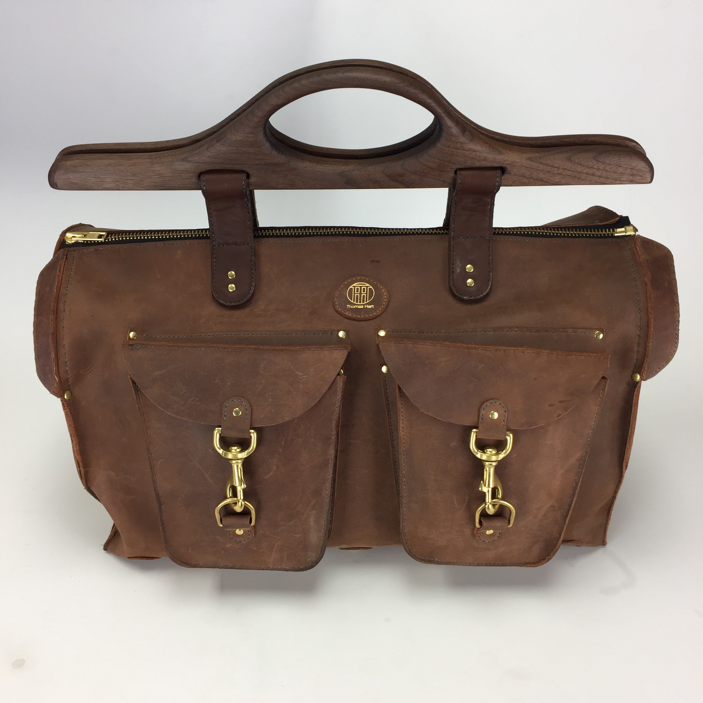 Saddle stitched large leather duffle bag with wood handles