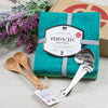 Bright turquoise and sea green kitchen towels, small tasting spoons, heart shaped measuring spoons