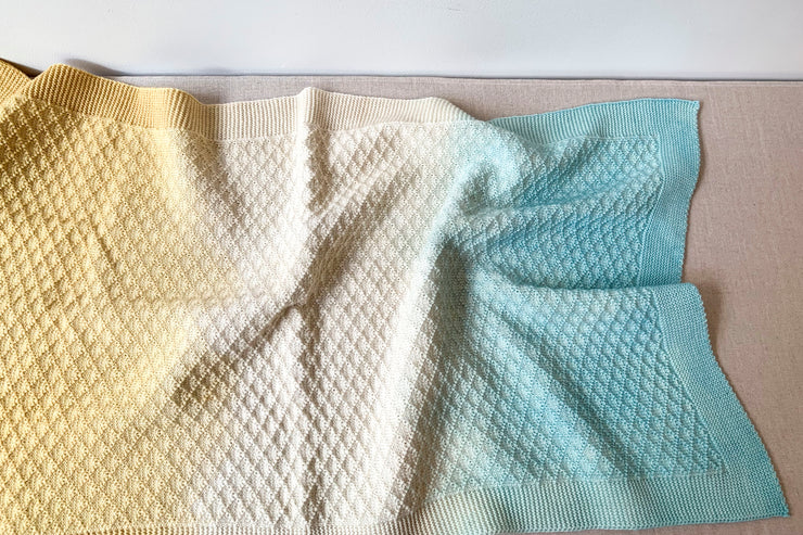 WOLI DIAMOND Couverture bébé fantaisie unie / knitted baby blanket