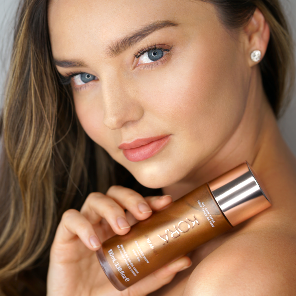 """I love the way this shimmering body oil makes my skin glow all over. I especially like to use it on my legs – it gives me a boost when I need a little extra color."" - Miranda"