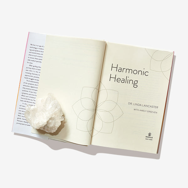 Harmonic Healing (Restore Your Vital Force For Lifelong Wellness) By Linda Lancaster with Clear Quartz crystal.