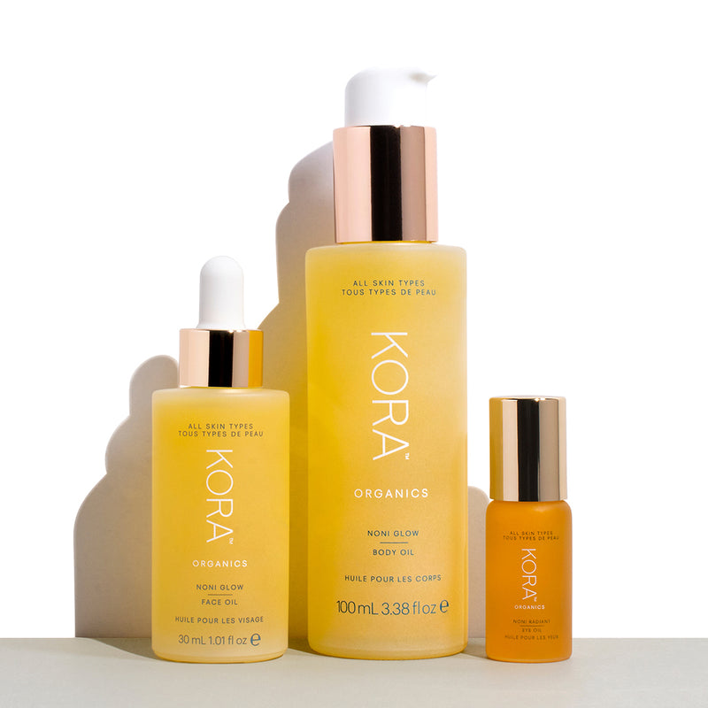 Noni Glow Essentials: Noni Glow Face Oil 30mL, Noni Glow Body Oil 100mL, Noni Radiant Eye Oil 10mL. Certified Organic Oils. KORA Organics.A collection of three full-sized Noni Glow Essentials to enhance your skincare ritual from head to toe. Smooth, nourish and brighten your skin with luxe oils rich in antioxidants and essential fatty acids to get your #NoniGlow.