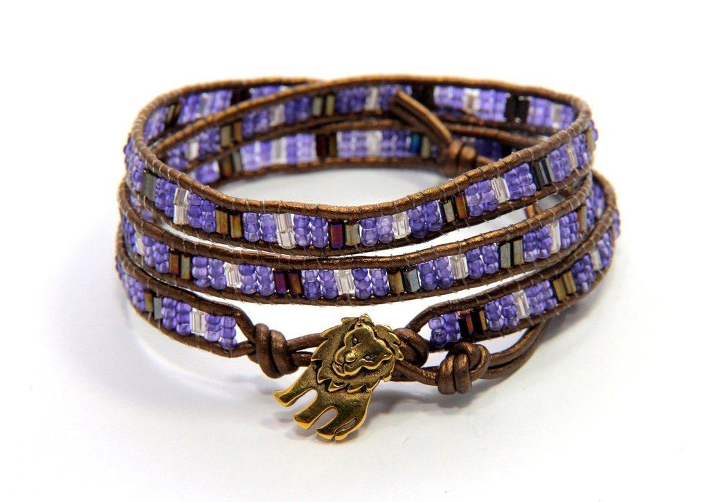 Pebble and Rose's Cecile Wrap Bracelet made with glass beads in purple hues with lion shaped clasp