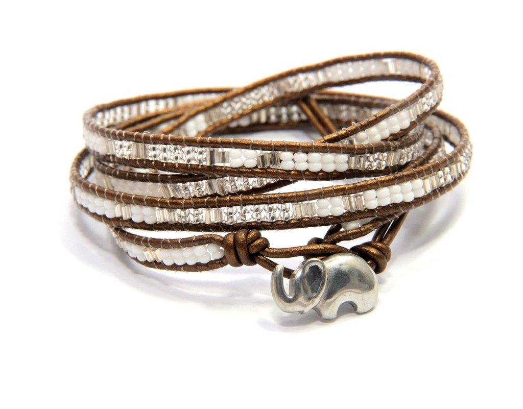 The Pebble and Rose elephant wrap bracelet with seed and glass beads shown on white