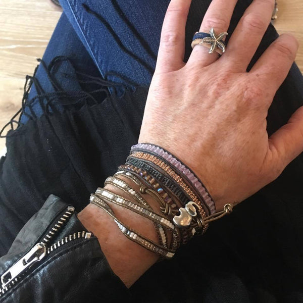 Pebble + Rose elephant wrap bracelet shown on wrist stacked with others