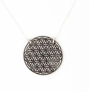 PEBBLE + ROSE artisan fine silver flower of life pendant necklace from Annie Diehl shown on white