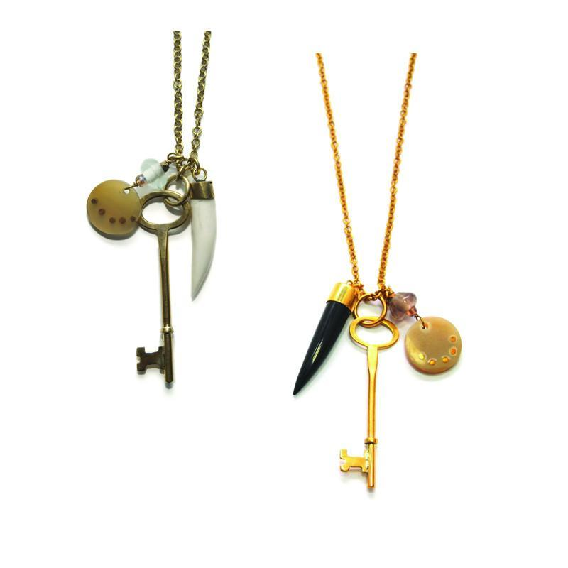 Pebble and Rose's key necklaces made by Kenyan artisans pictured in two color options with charms.