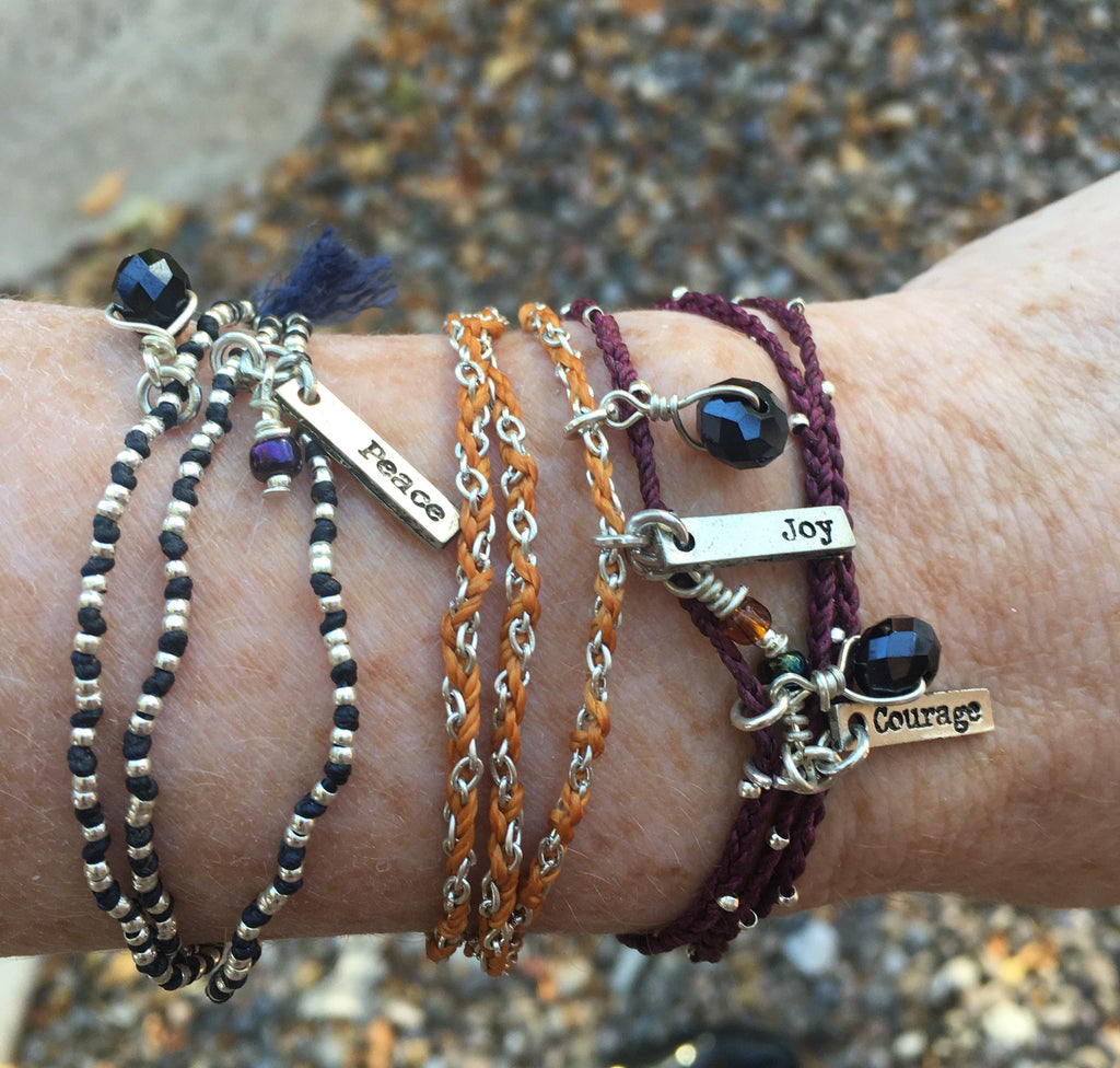 PEBBLE + ROSE Jewelry - Life's Gift Charm Necklace/Bracelet shown on wrist