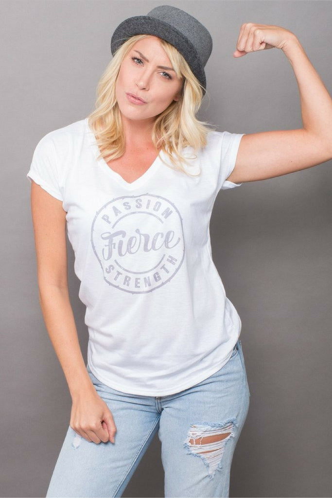 PEBBLE + ROSE's feminist Fierce T Shirt in white shown on model with grey hat and flexed arm