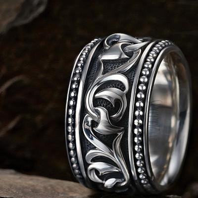 An Unkaged Sparta Engraved Knotted Vine Band Style Ring