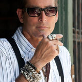 Guy Wearing Skull Rings and Sterling Silver Bracelets