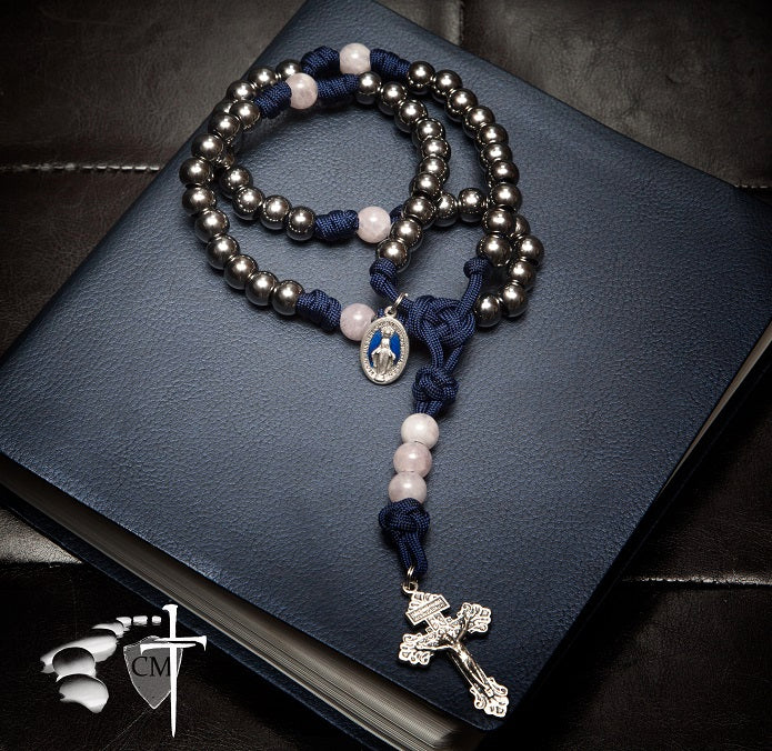 Paracord rosary with rose quartz beads pray to Jesus Christ His only Son our Lord