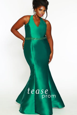 TE1829 in emerald green is a fit and flare silhouette made in Mikado satin. The V-neckline looks great above a natural waistline with clear marquise-shaped, tone-on-tone sequins on the beaded belt
