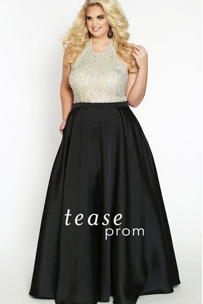 TE1837 in black is a halter dress decorated with silver sequins and beads on the bodice. An A-line skirt to the floor is made from Mikado satin