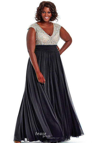 TE1602 in Black rippling chiffon skirt in a floor length silhouette An illusion cap sleeved and heavily beaded bodice has a deep v neckline