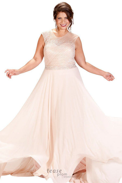 TE1724 in blush pink has hand-sewn beads across the illusion bodice with a flowing chiffon skirt and key hole back
