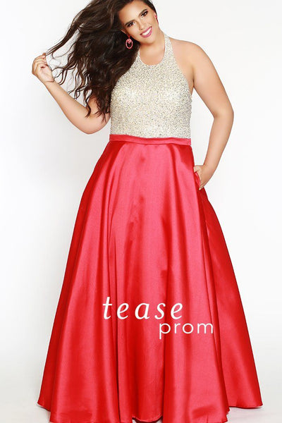 TE1837 in red is a halter dress decorated with silver sequins and beads on the bodice. An A-line skirt to the floor is made from Mikado satin